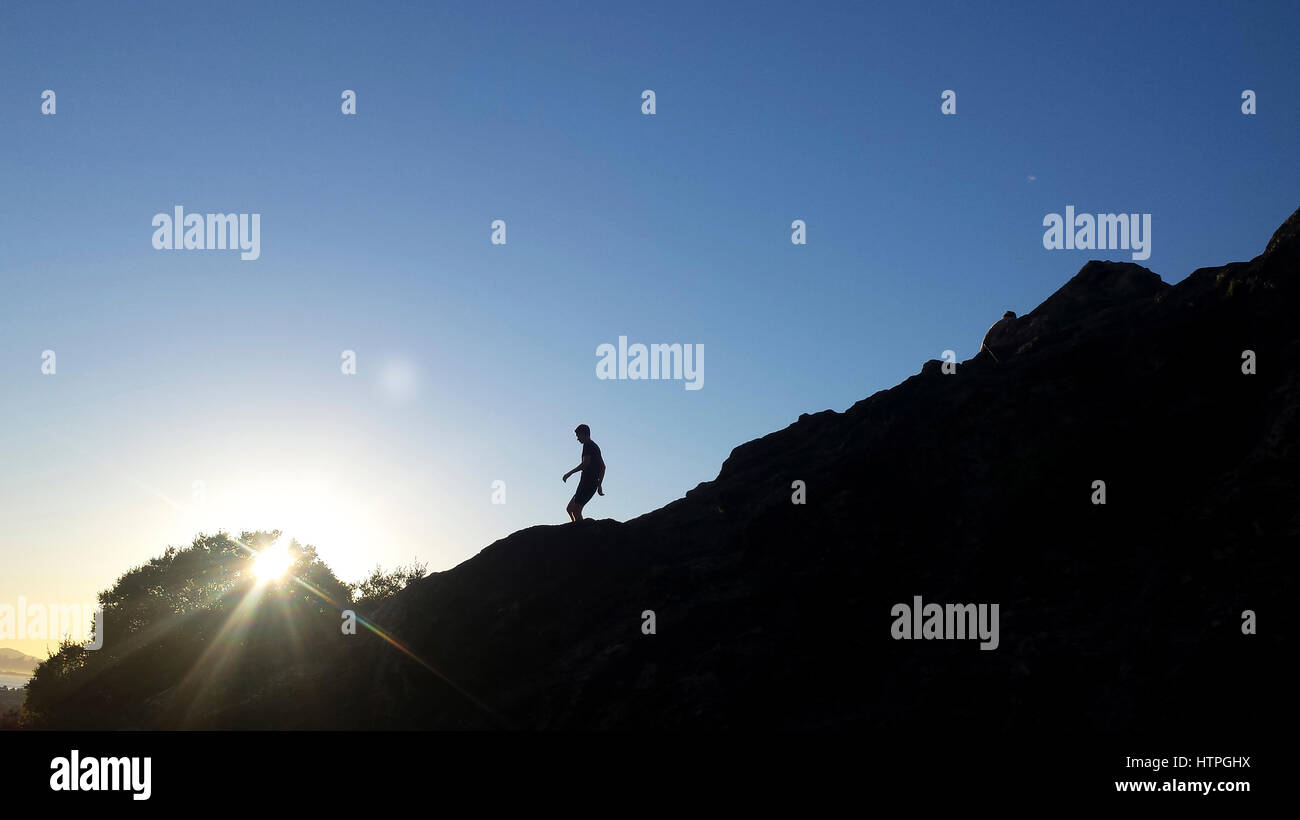 A hiker on the hills above San Francisco bay in Berkeley, California. - Stock Image
