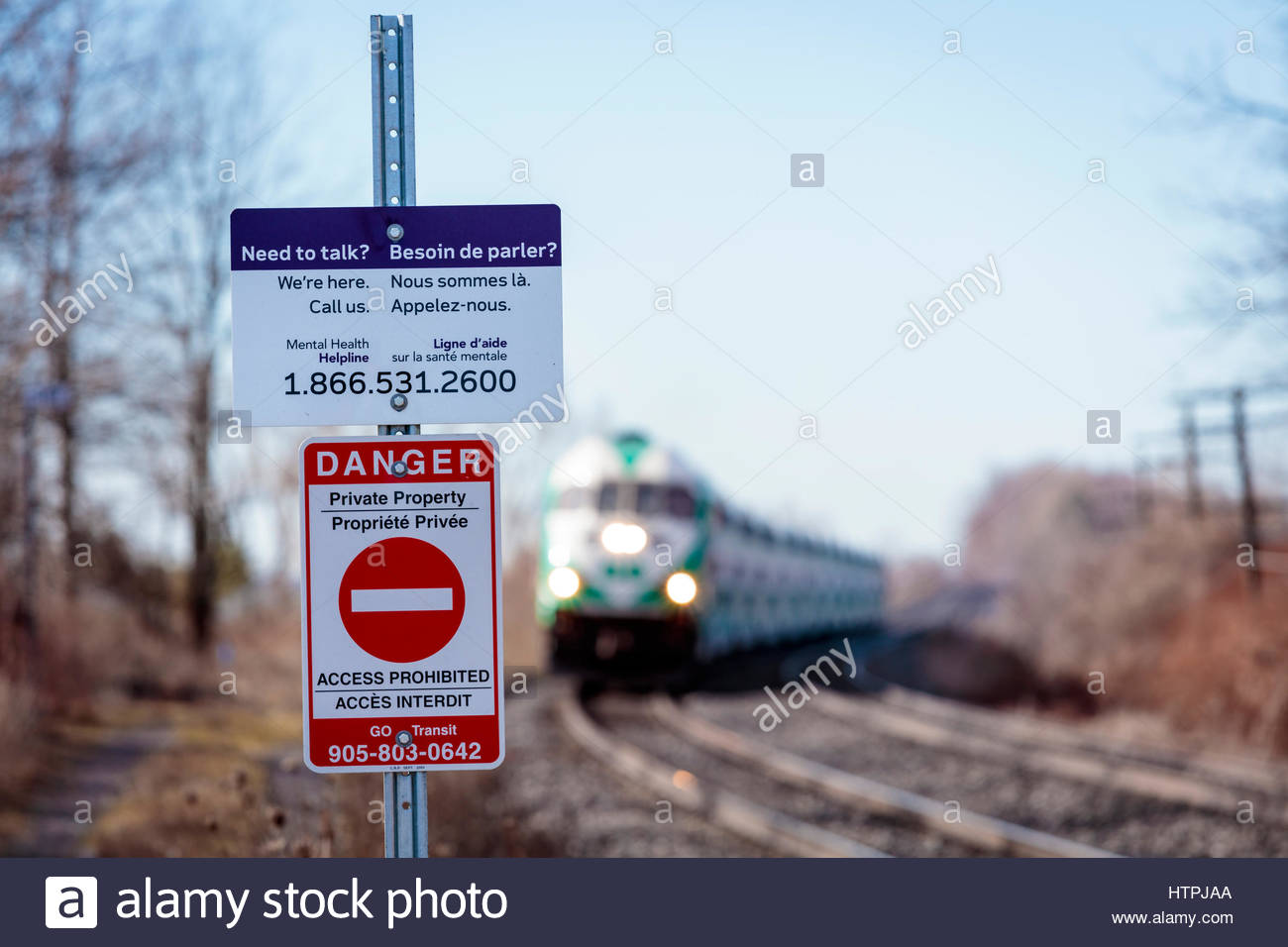 Suicide prevention sign at railway level crossing to prevent suicide by train in Ontario Canada Stock Photo