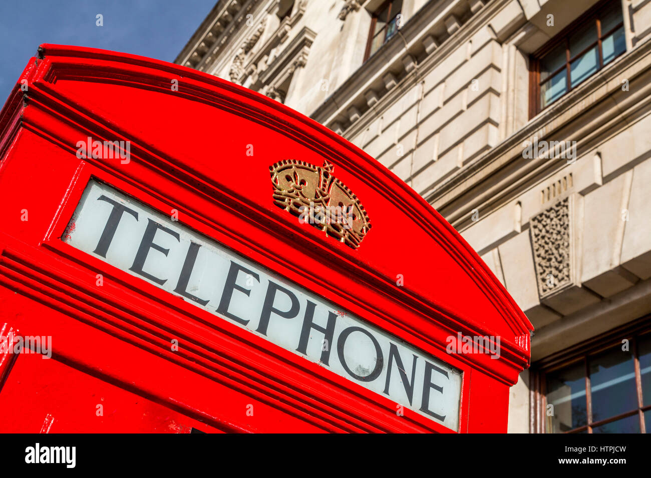 A red telephone box near Westminster, London, England - Stock Image