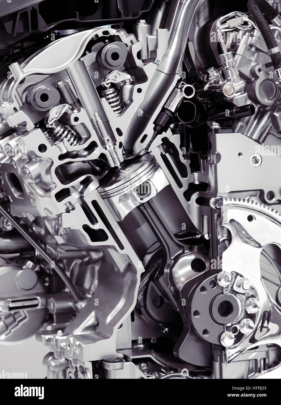 Closeup cross section of 2017 Buick Lacrosse 3.6L V6 VVT DI 310HP car engine showing the cylinder, piston and valves - Stock Image