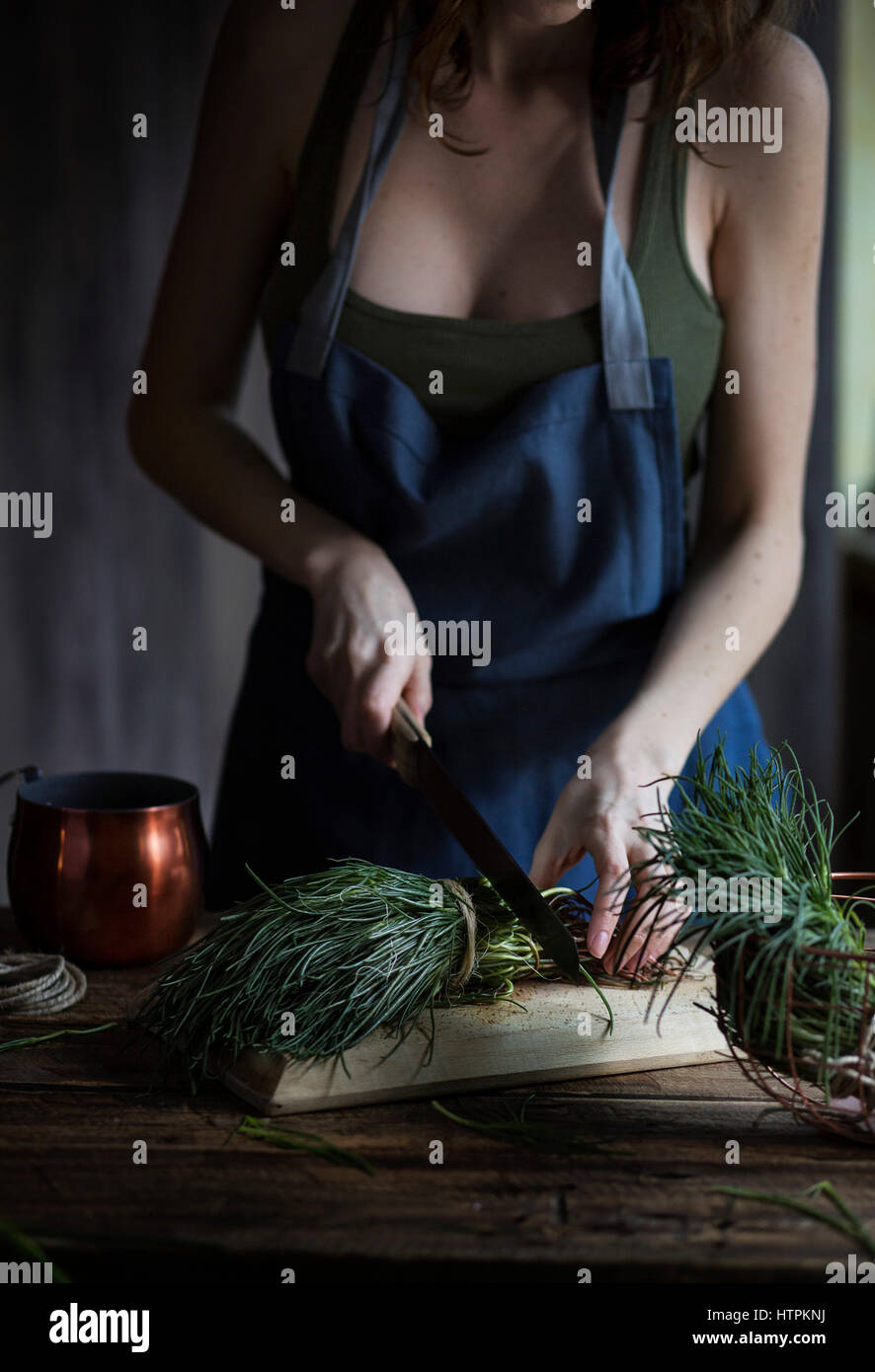 Woman cutting agretti, a typical italian spring vegetables - Stock Image