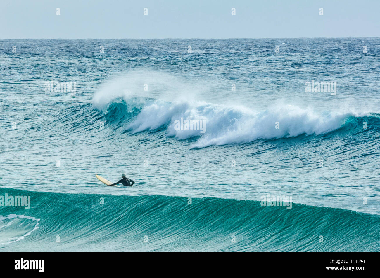 A surfer waits for the perfect wave, Dalmeny, South Coast, New South Wales, NSW, Australia - Stock Image