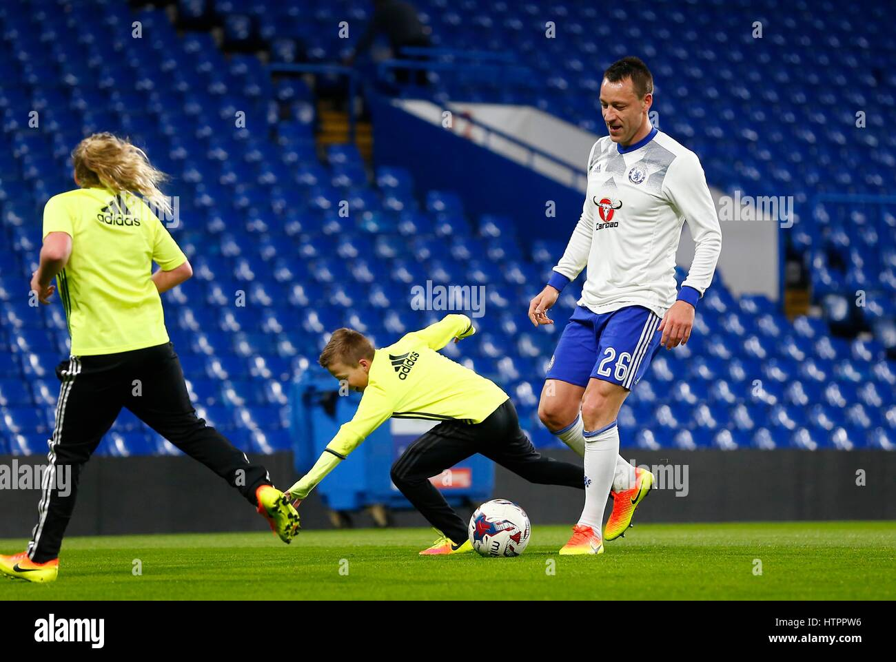 John Terry of Chelsea plays with his kids after  the FA Cup match between Chelsea and Manchester United at Stamford - Stock Image