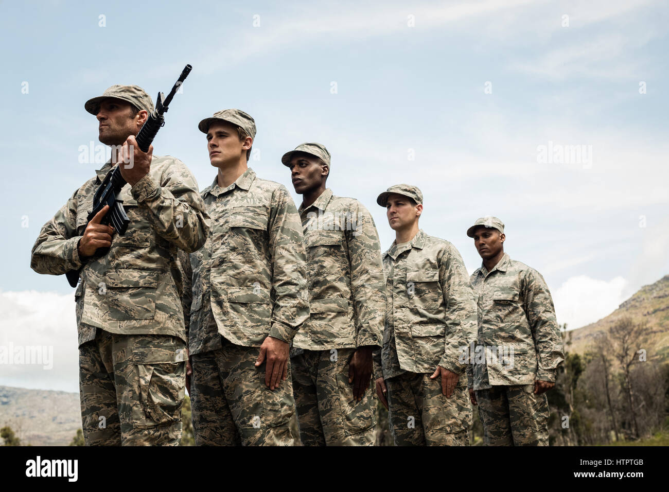 Group of military soldiers standing in line at boot camp - Stock Image