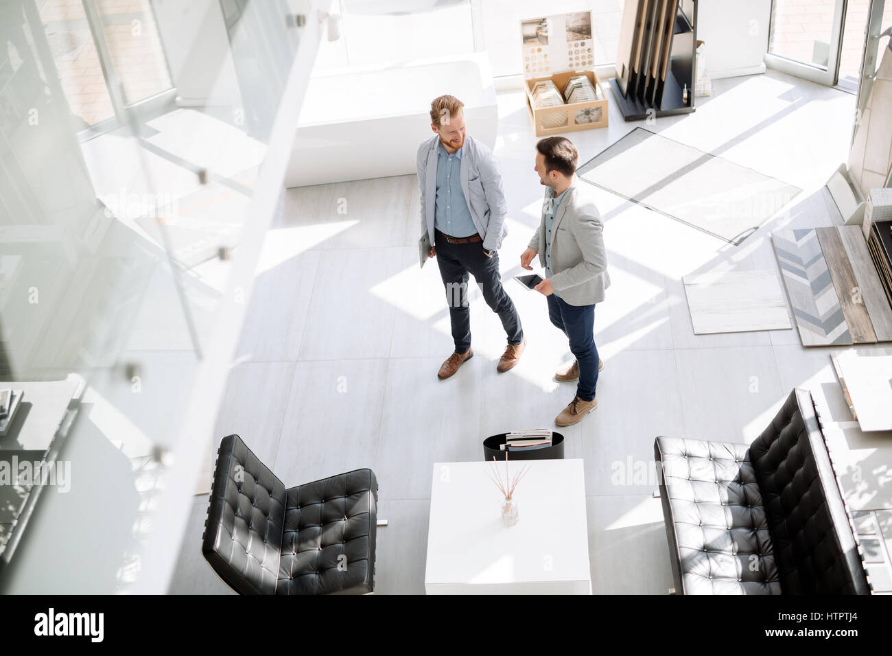 Two customers entering interior design store - Stock Image