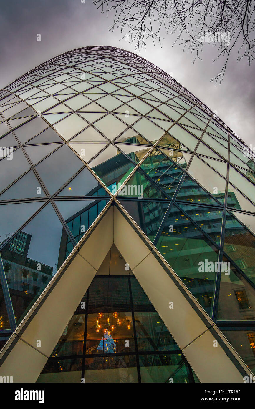 30 St Mary Axe (informally known as The Gherkin and previously as the Swiss Re Building) is a commercial skyscraper - Stock Image