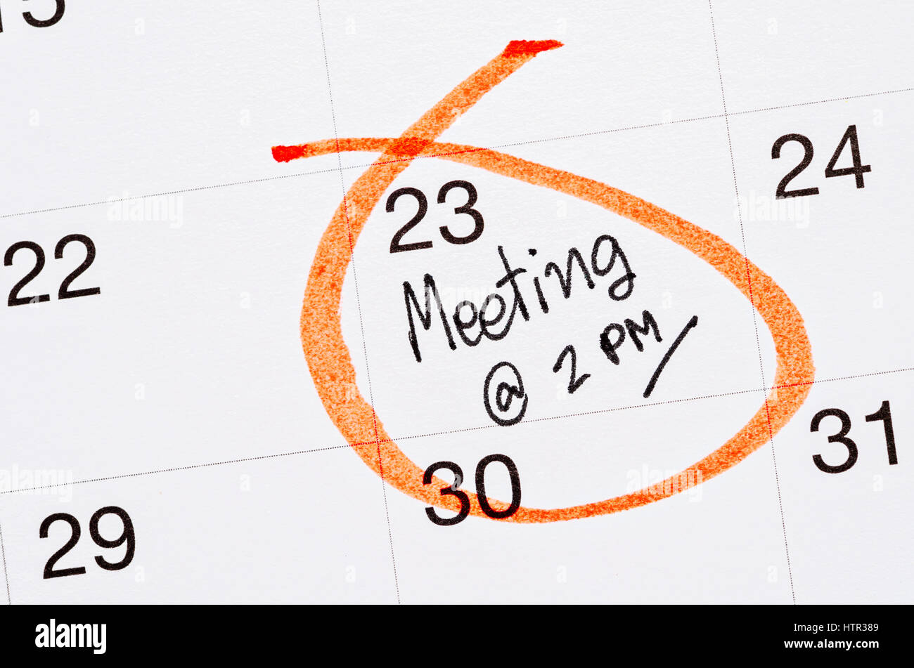 Meeting appointment written in a calendar page - Stock Image