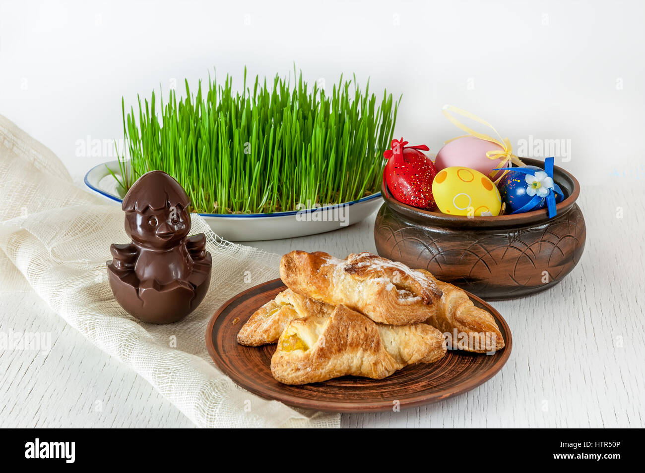 biscuits, sweet chocolate chick fresh green grass colored eggs in Easter songs - Stock Image