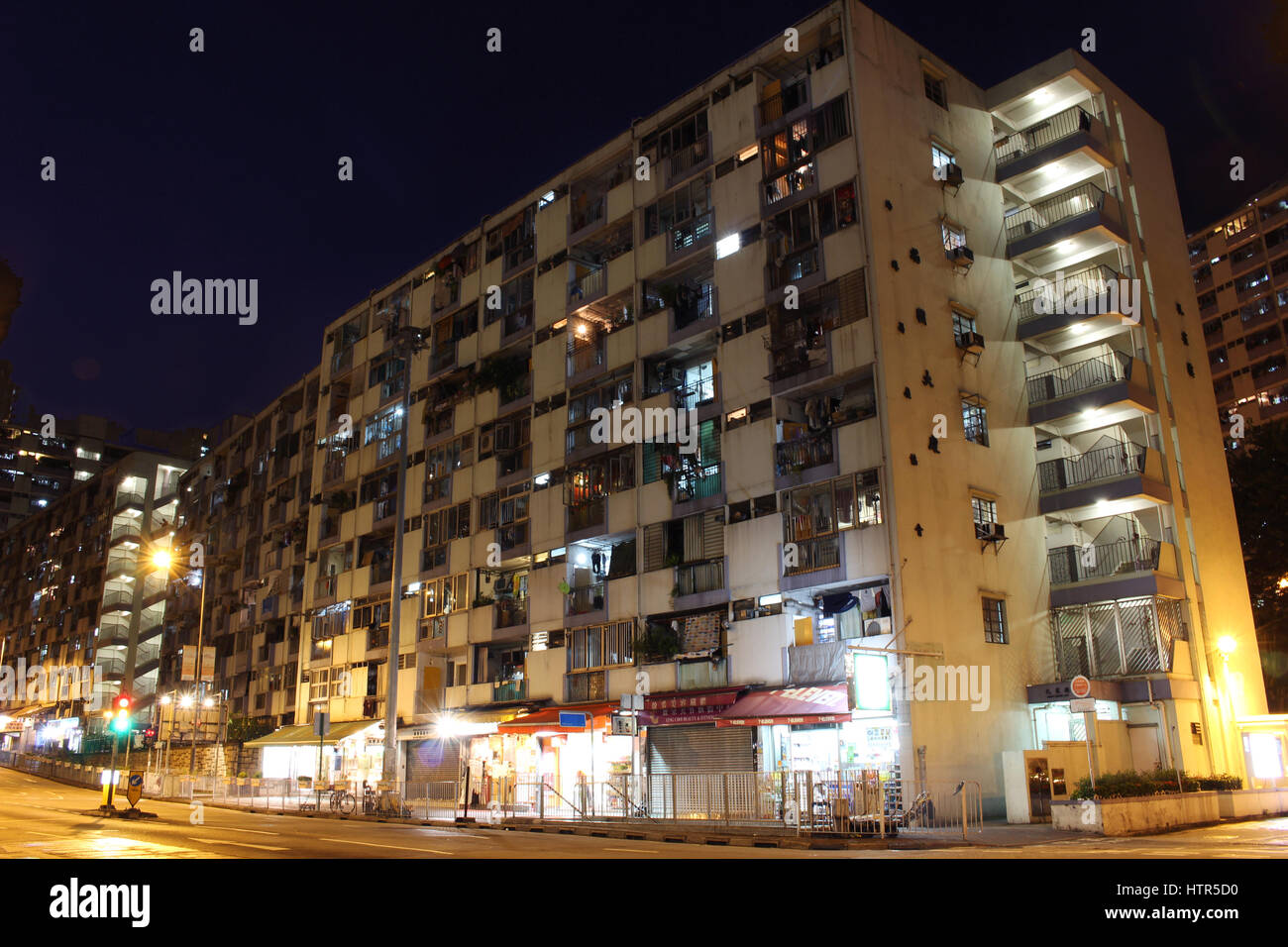 Exterior of an old public housing built by the government in ngau tau kok, Hong Kong, at night - Stock Image