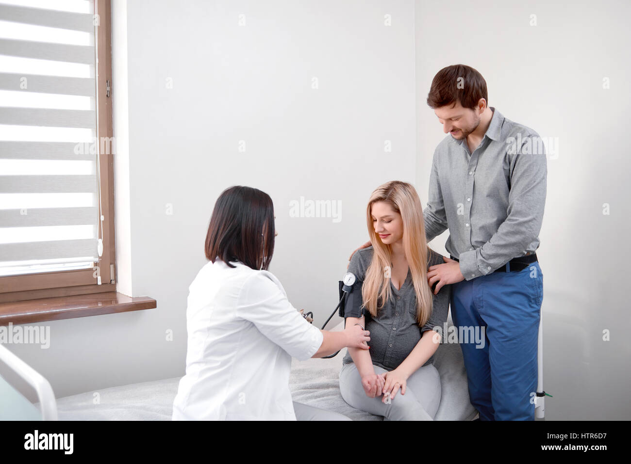 Measuring blood pressure for pregnant woman. - Stock Image