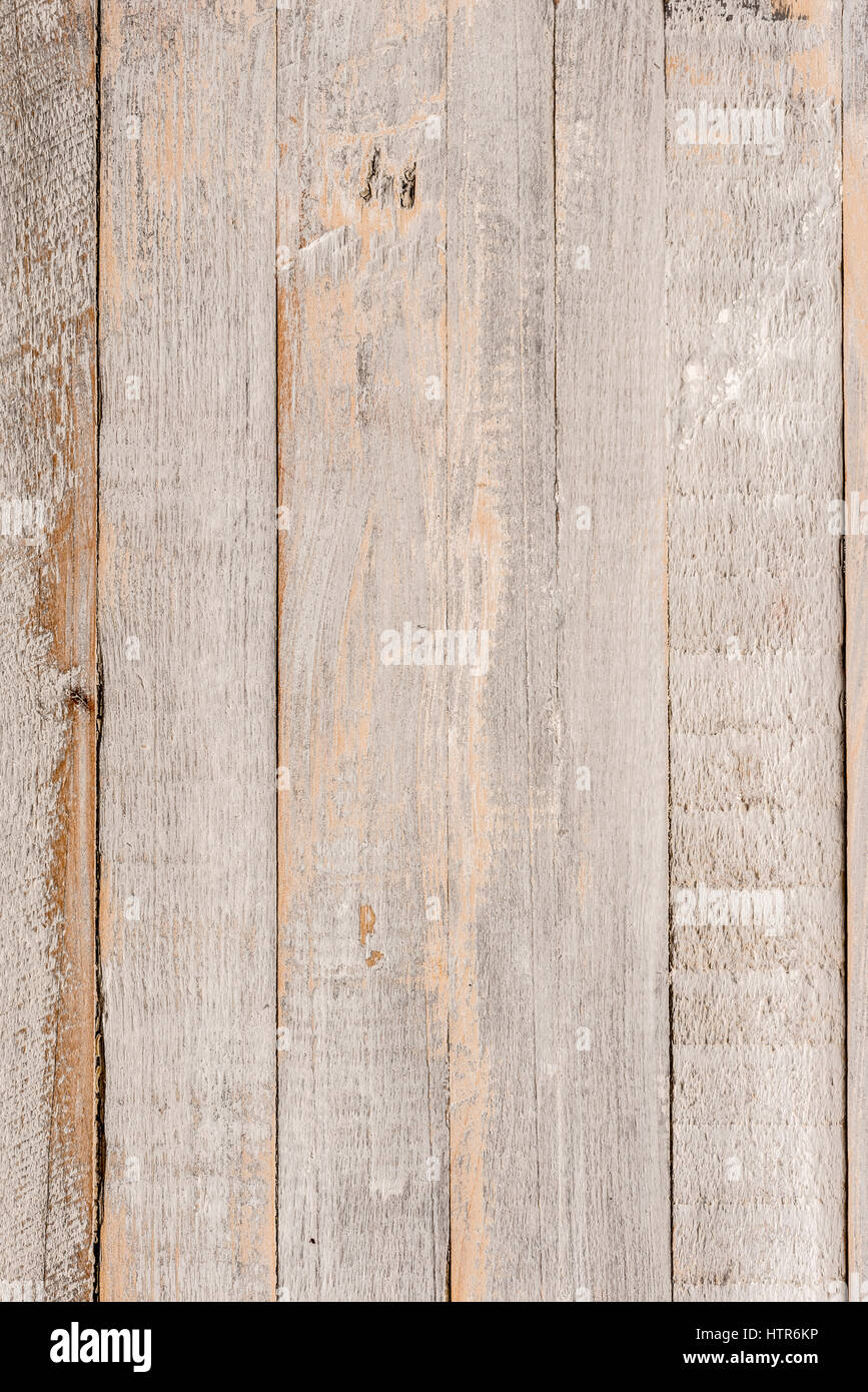 Wooden painted distressed panel made up of  vertical boards - Stock Image
