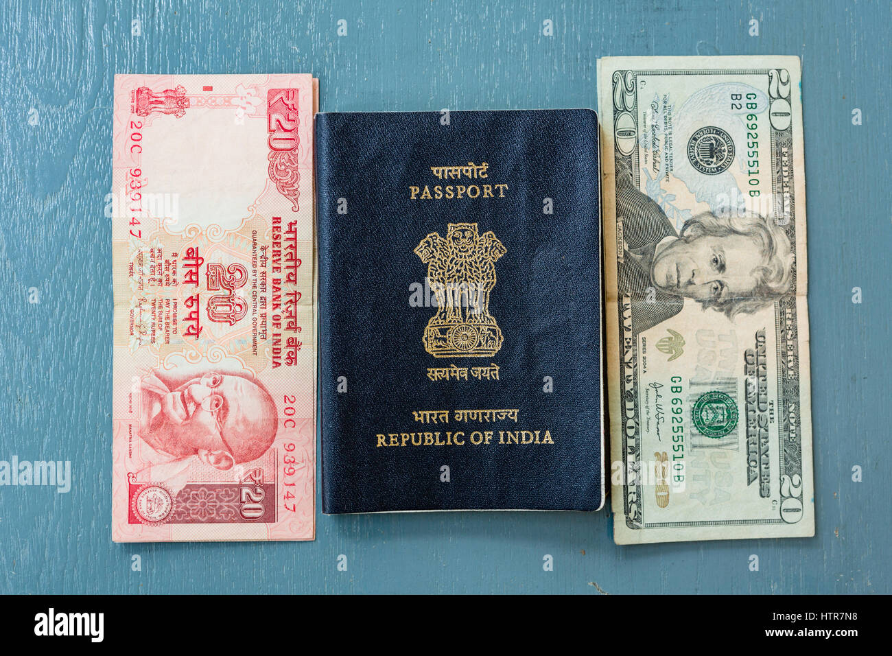 Close-up of Indian 20 Rupee Note and American 20 Dollar bill and
