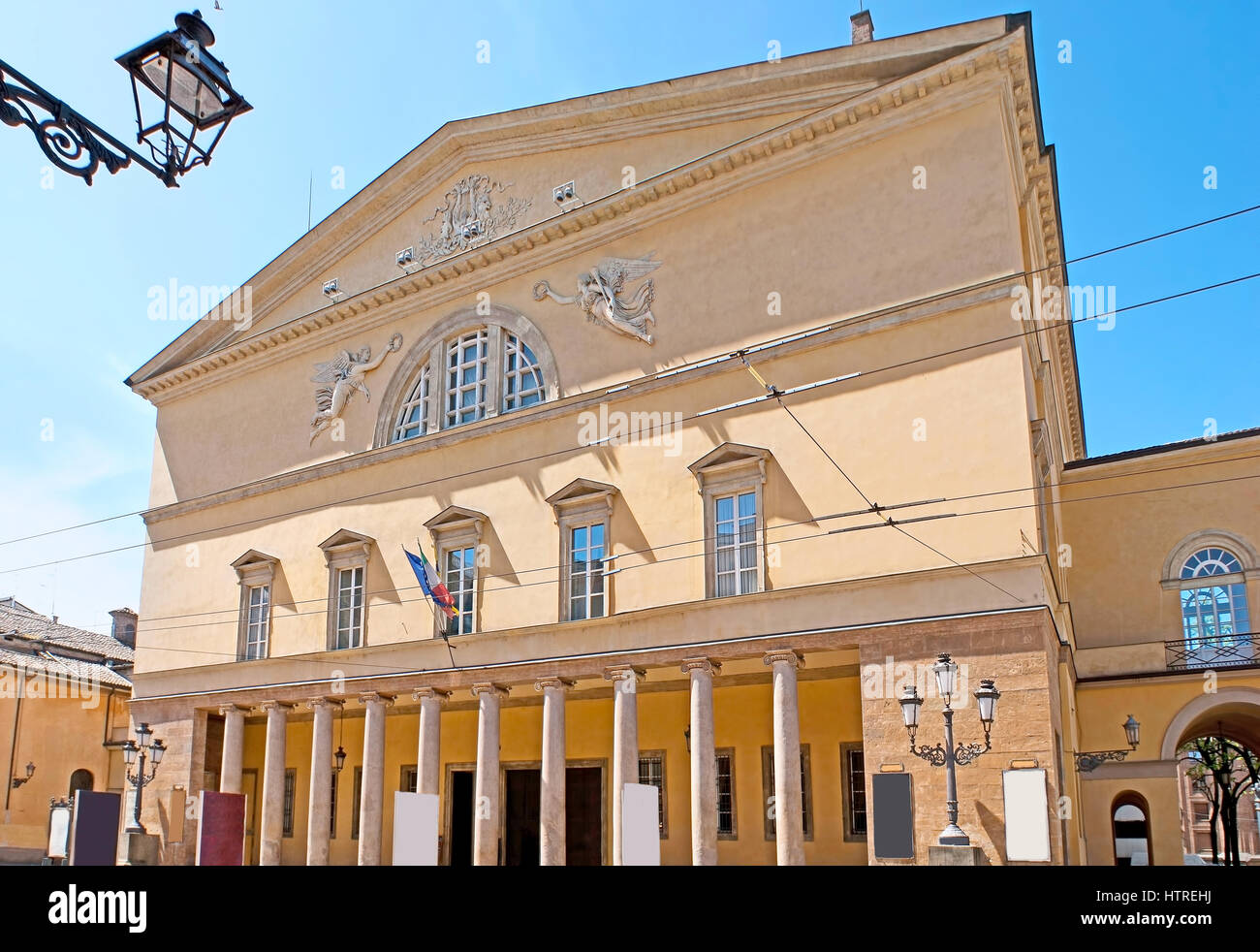 The facade of Parma Opera House, named Teatro Regio or New Ducal Theater, faces the Garibaldi Street, Italy. - Stock Image