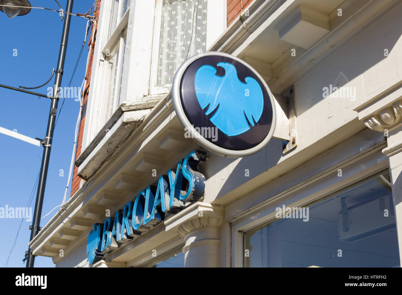 Barclays Bank sign on the branch in Llangollen Denbighshire, one of the few remaining banks maintaining a presence - Stock Image