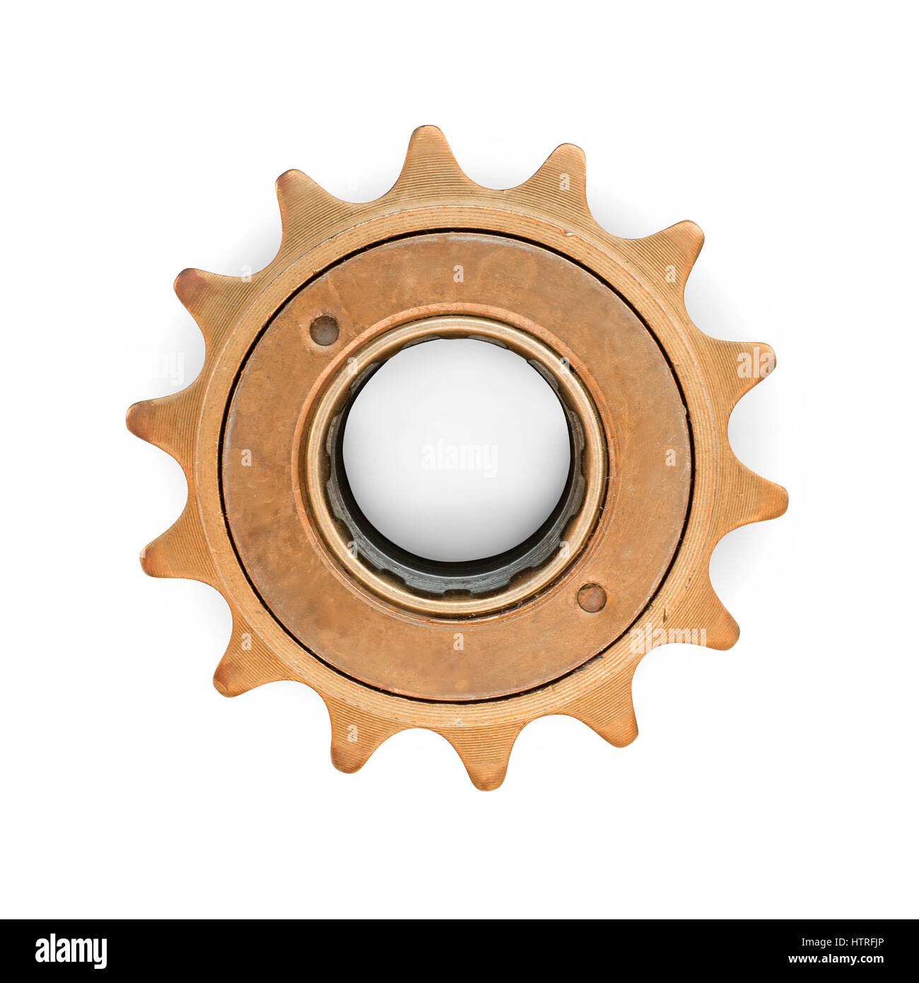 Bronze colored gear. Vintage bicycle part. Isolated on white, clipping path included - Stock Image