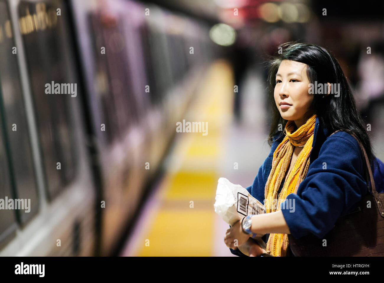 Woman waiting for the subway. - Stock Image