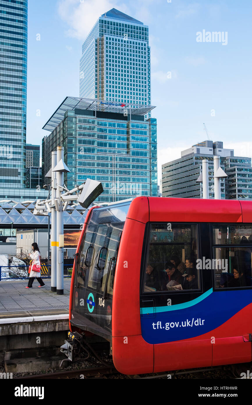 Poplar DLR Station in front of Canary Wharf Office Towers, London, England, U.K. - Stock Image
