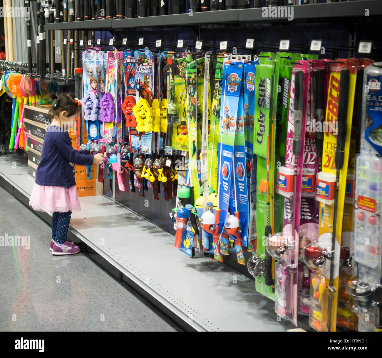 a03b9803df A child inspects childrens  fishing equipment in the new Dick s Sporting  Goods store in the