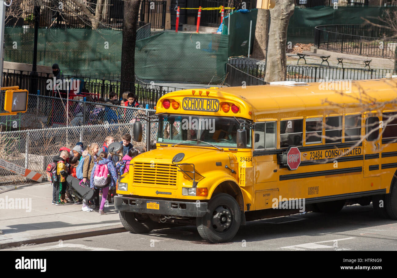 School buses line up in front of PS 33 in Chelsea in New York on Monday, March 13, 2017. Because of the approaching - Stock Image
