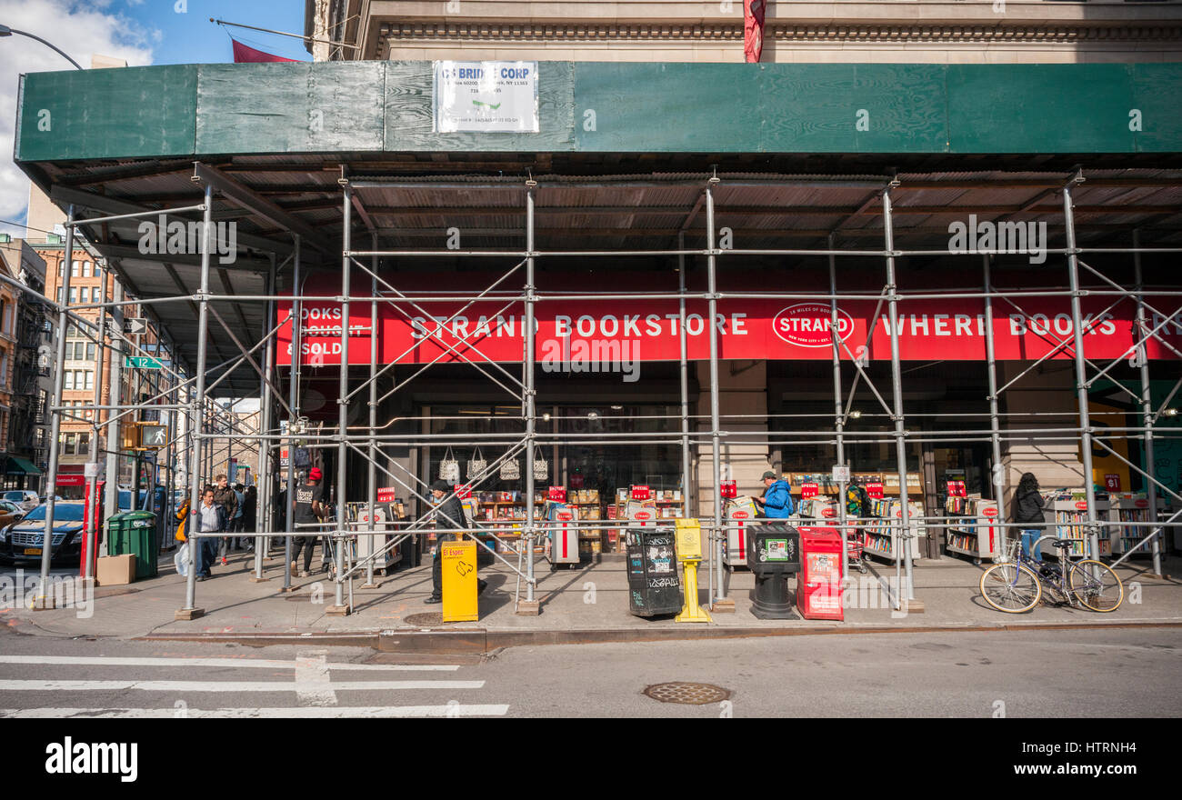 The Strand Bookstore in the New York neighborhood of Greenwich Village is covered by scaffolding, seen on Wednesday, - Stock Image