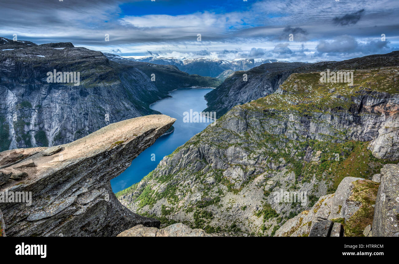 The amazing Trolltunga in Norway. Legend has it that a playful Troll wanted to test the legends and stuck his tongue - Stock Image