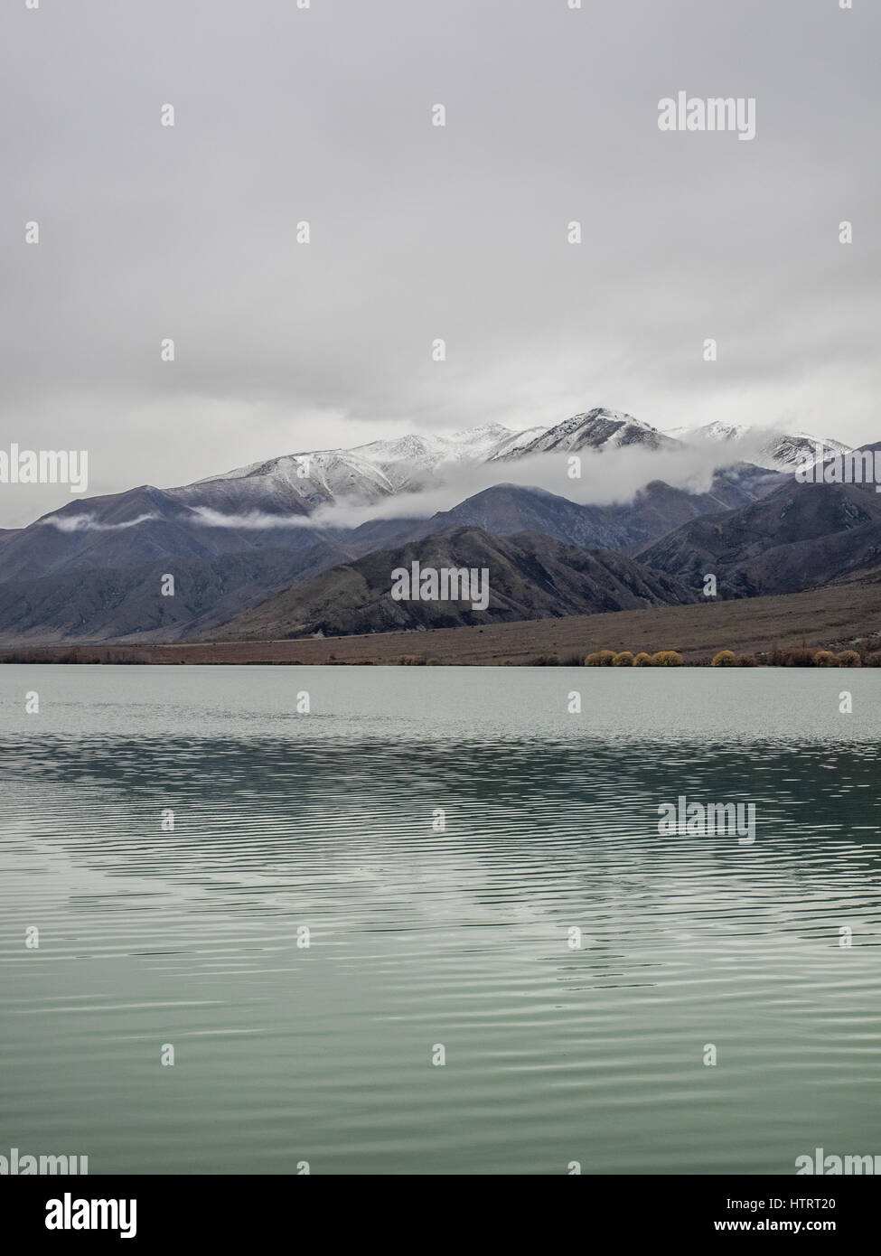 Lake Aviemore Man-made hydro lake, part of the Waitaki hydroelectric scheme, New Zealand. Alpine lake, sky & - Stock Image