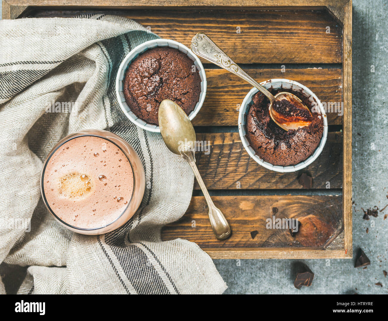 Chocolate souffle in individual baking cups and mocha coffee - Stock Image