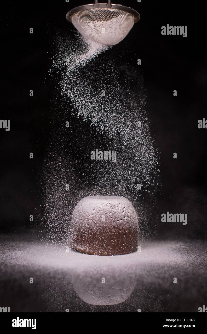 Chocolate Fondant Cake With Icing Sugar - Stock Image