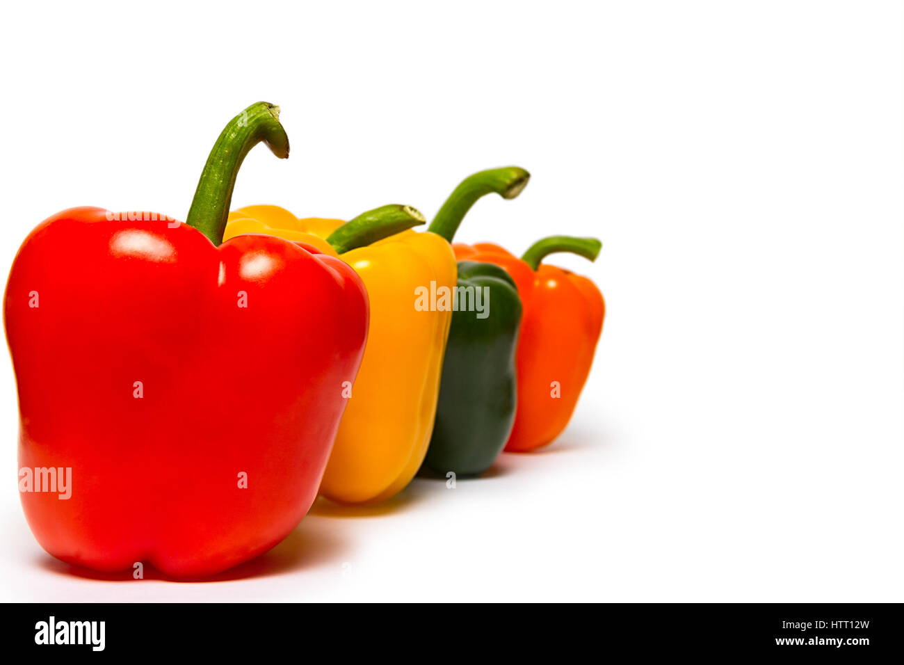 Red green and orange sweet bell peppers isolated on white background - Stock Image