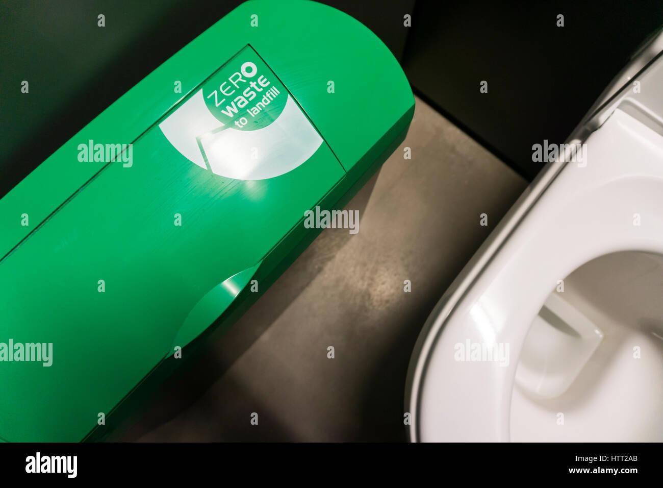 Zero Waste to Landfill sign on a waste bin in a public toilet, Brighton. - Stock Image