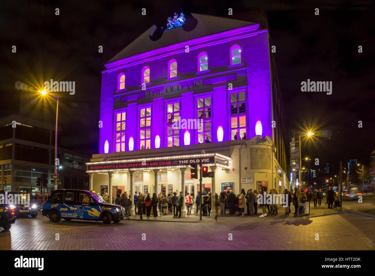 The Old Vic at night with people queuing to see Rosencrantz and Guildenstern are Dead by Tom Stoppard. - Stock Image
