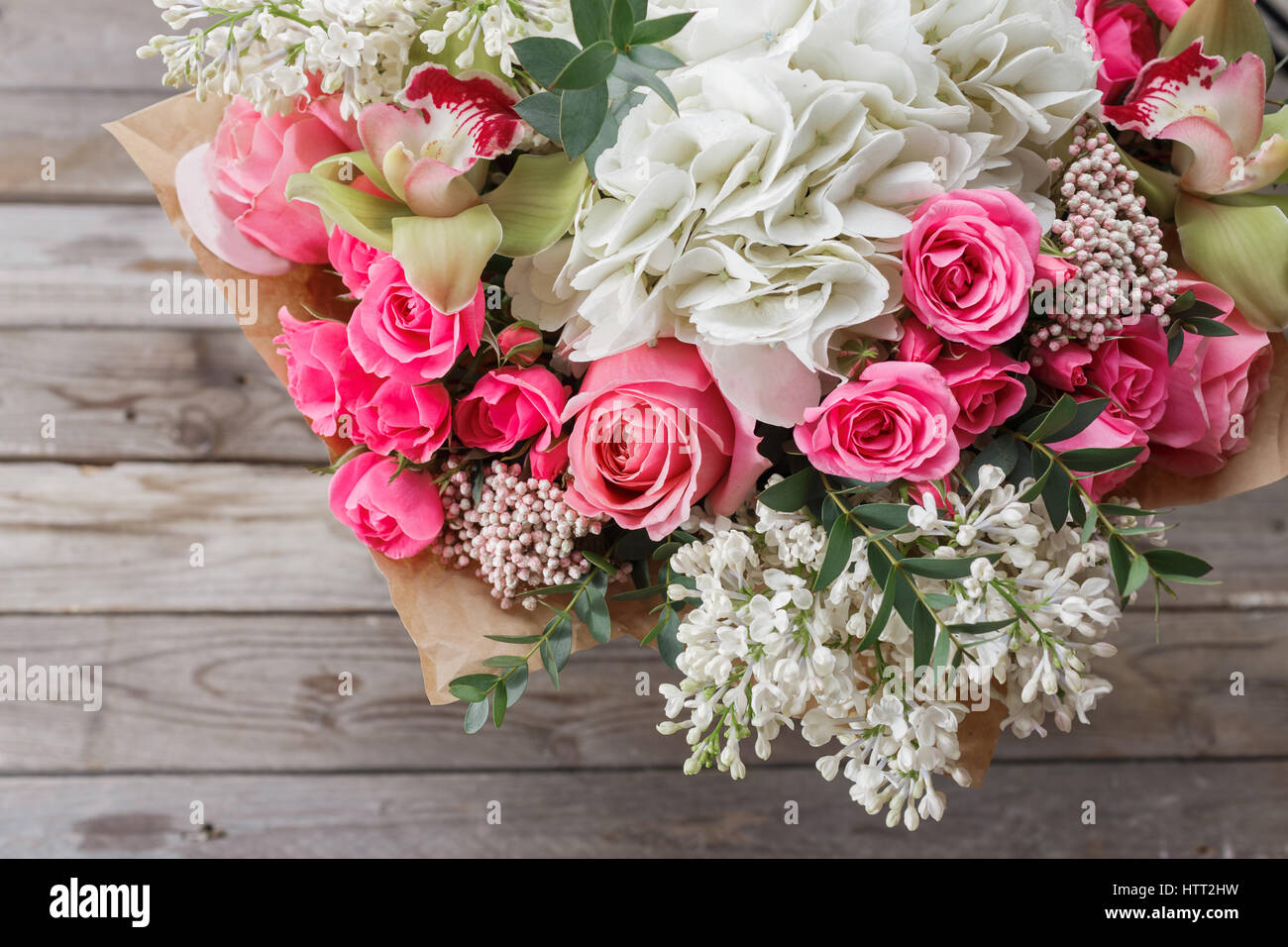 Luxury bouquet of different flowers in glass vase on wooden wall luxury bouquet of different flowers in glass vase on wooden wall copy space izmirmasajfo