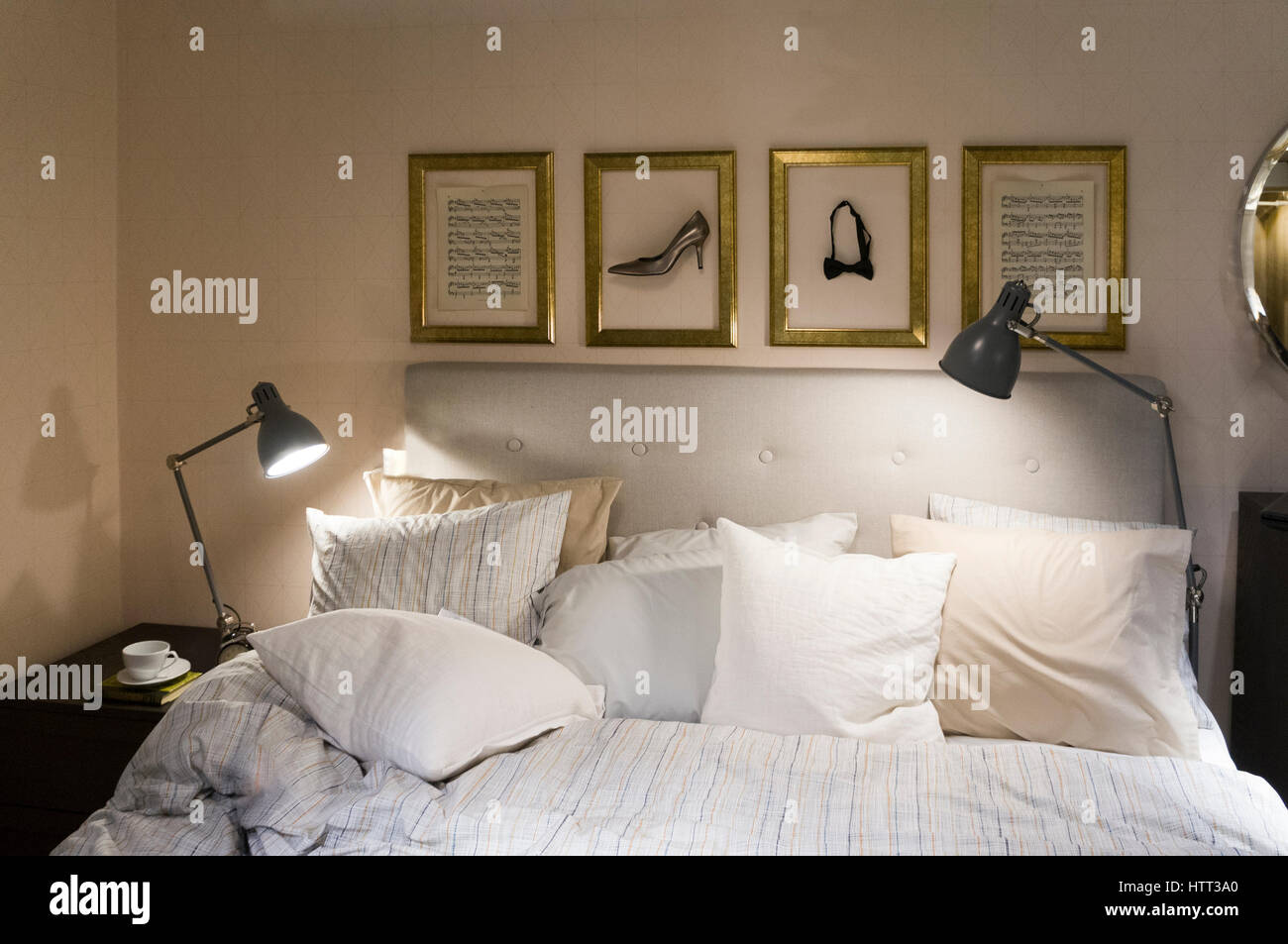 Cosy comfortable modern bedroom and bed  Model Release: No.  Property Release: No. - Stock Image