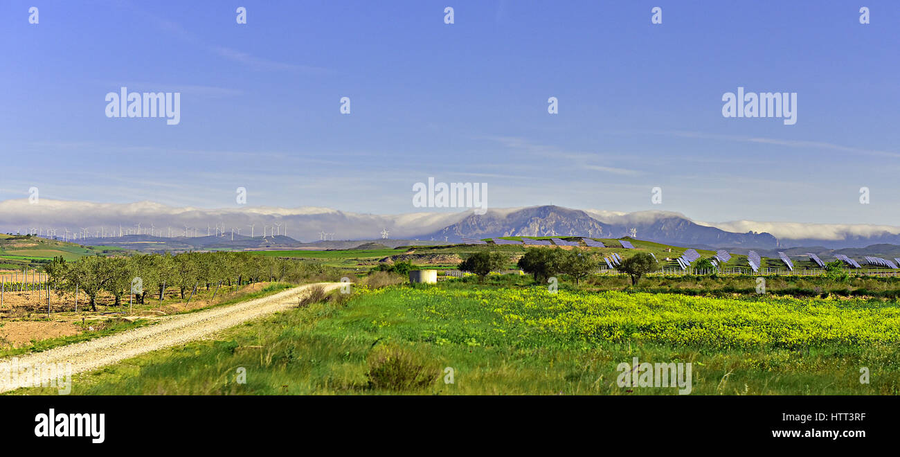 Solar Panels and Windmill Farms with Spanish Cordillera Contabrica - Cantabrian Mountains - seen from the Camino - Stock Image