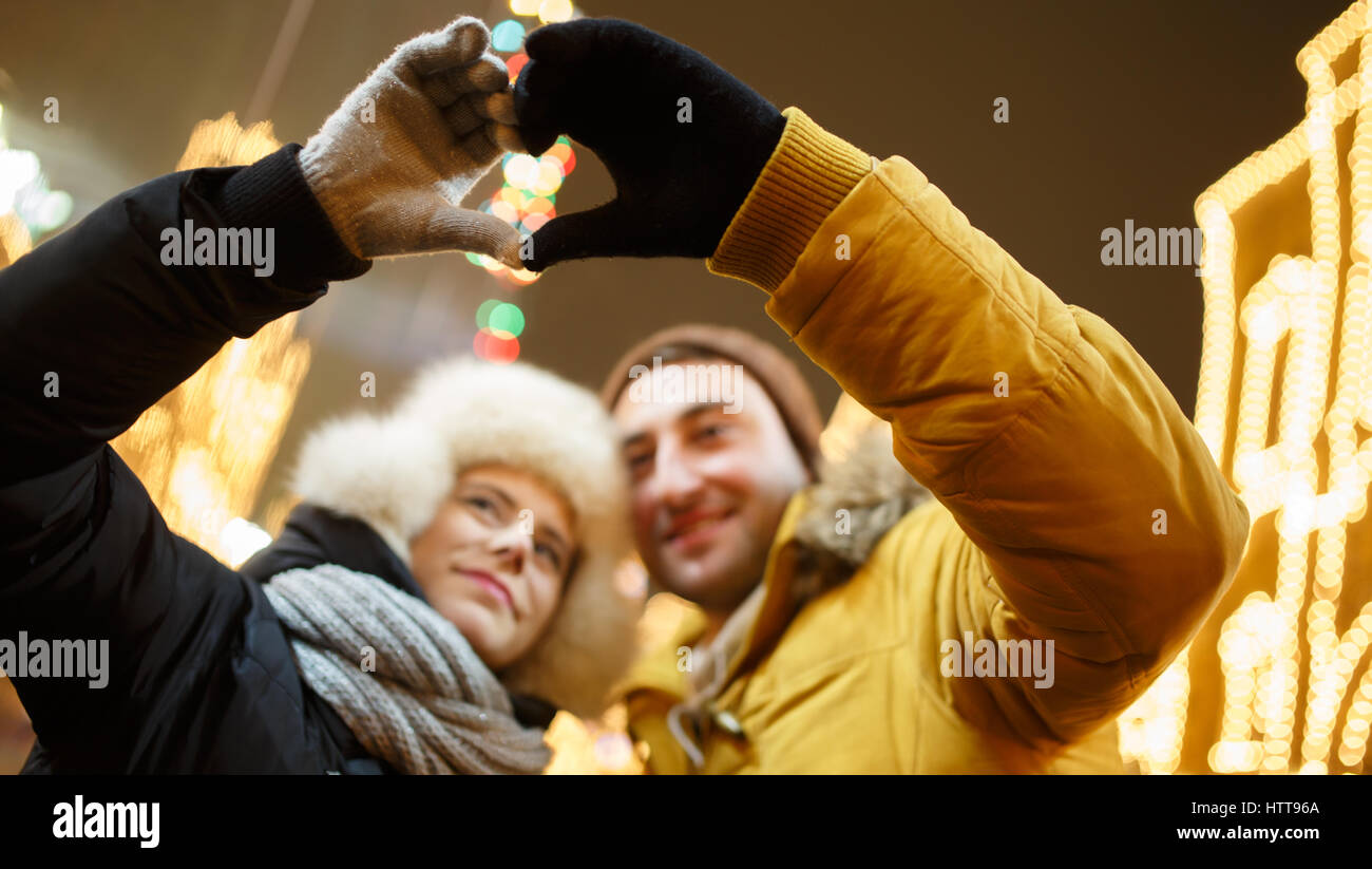 Couple does from hands heart - Stock Image