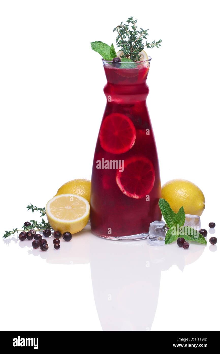 Cold drink with black currant, lemon, mint and thyme Stock Photo