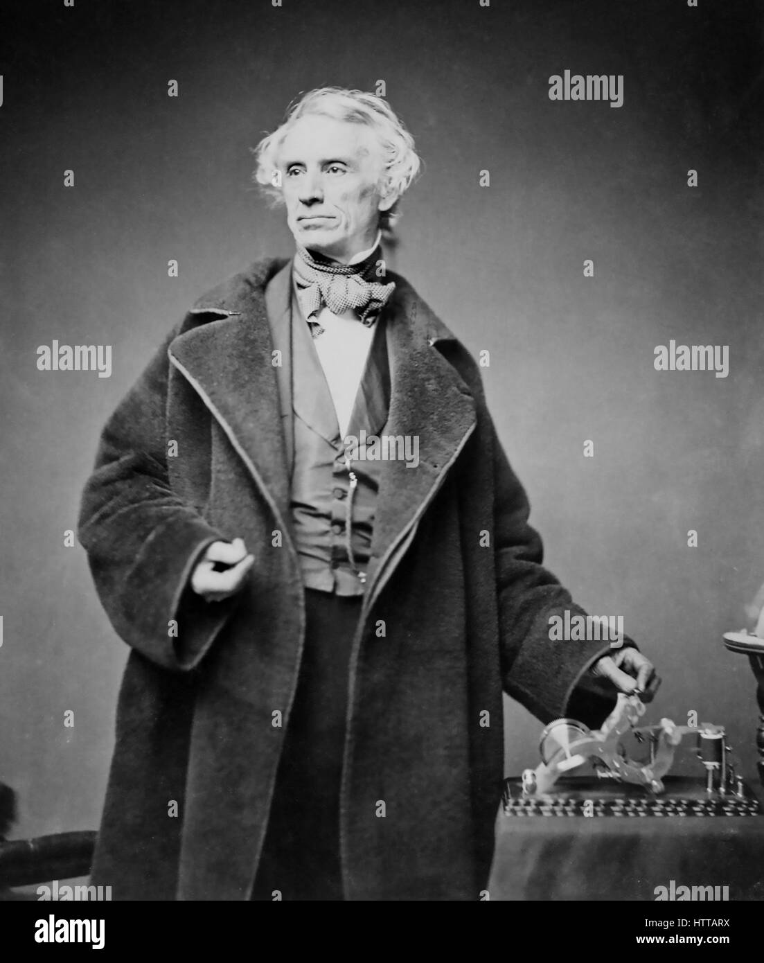 SAMUEL MORSE (1791-1872) with his telegraph transmitter photographed by Matthew Brady in 1857 - Stock Image