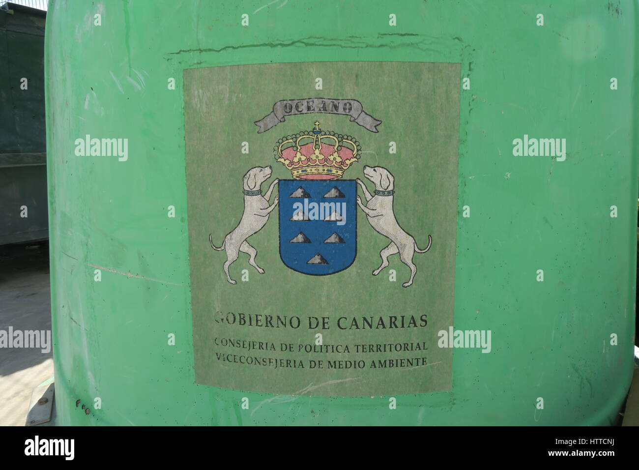 Crest on a bottle bank in the Canary Islands - Stock Image