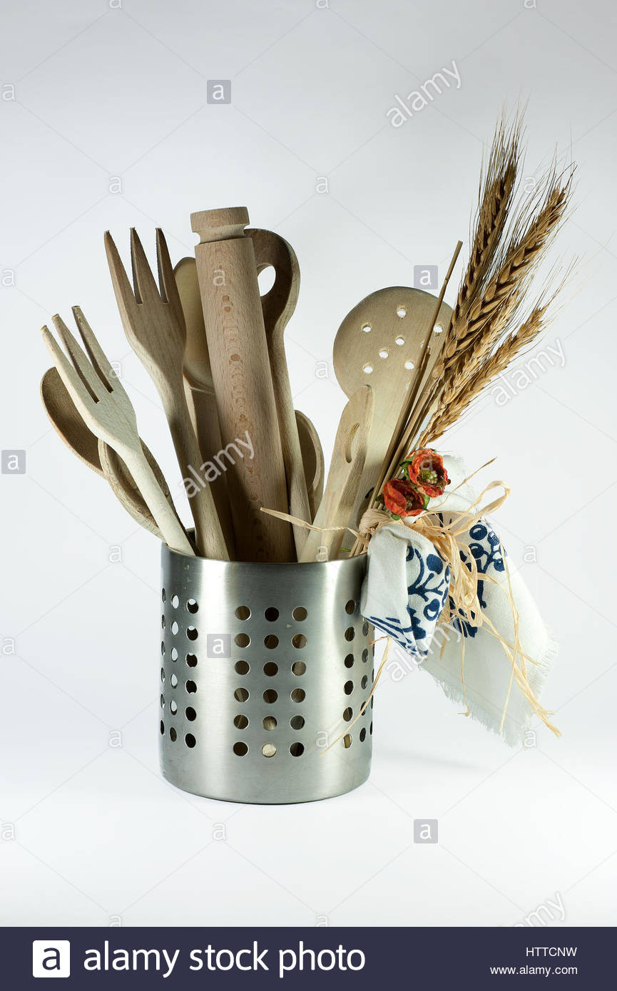 wooden kitchen utensils in steel basket and ears of corn. made on a white background to bring out every little detail. - Stock Image