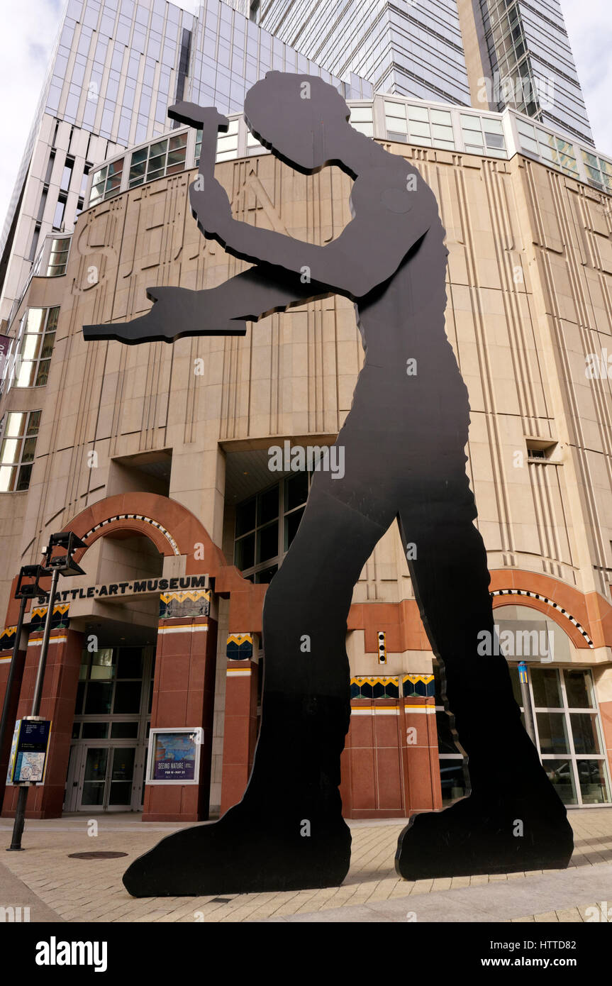 The Hammering Man kinetic sculpture by Jonathan Borofsky in front of the Seattle Art Museum building, Seattle, Washington, - Stock Image