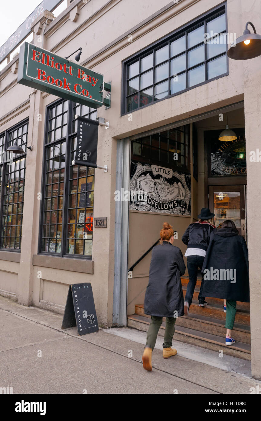 Young women entering the Elliot Bay Book Company bookstore in the Capitol Hill neighborhood of Seattle, Washington, - Stock Image
