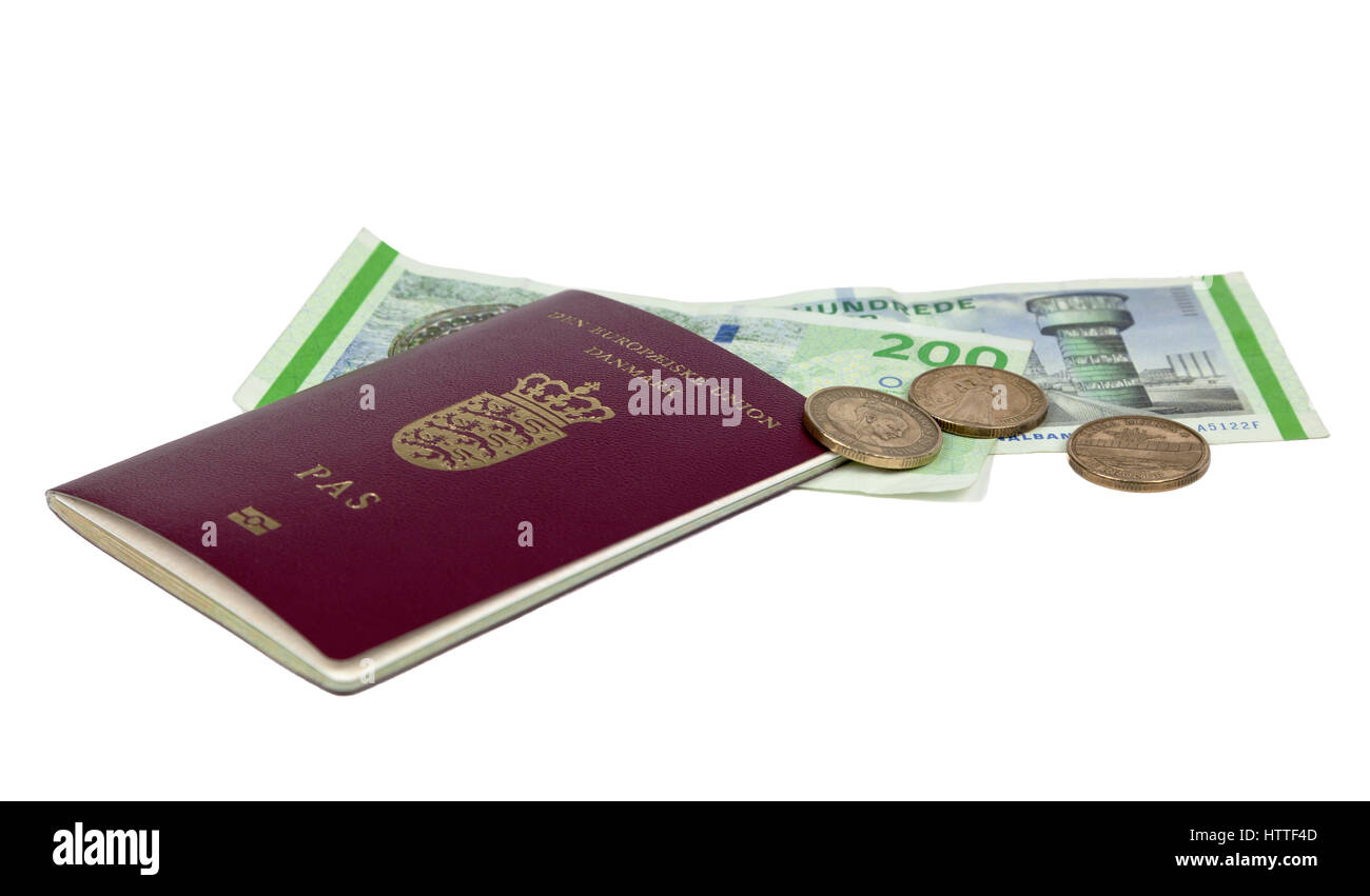 A Danish passport, European Union, nicknamed the beetroot passport, and Danish 20 kroner coins and 200 kroner bank - Stock Image