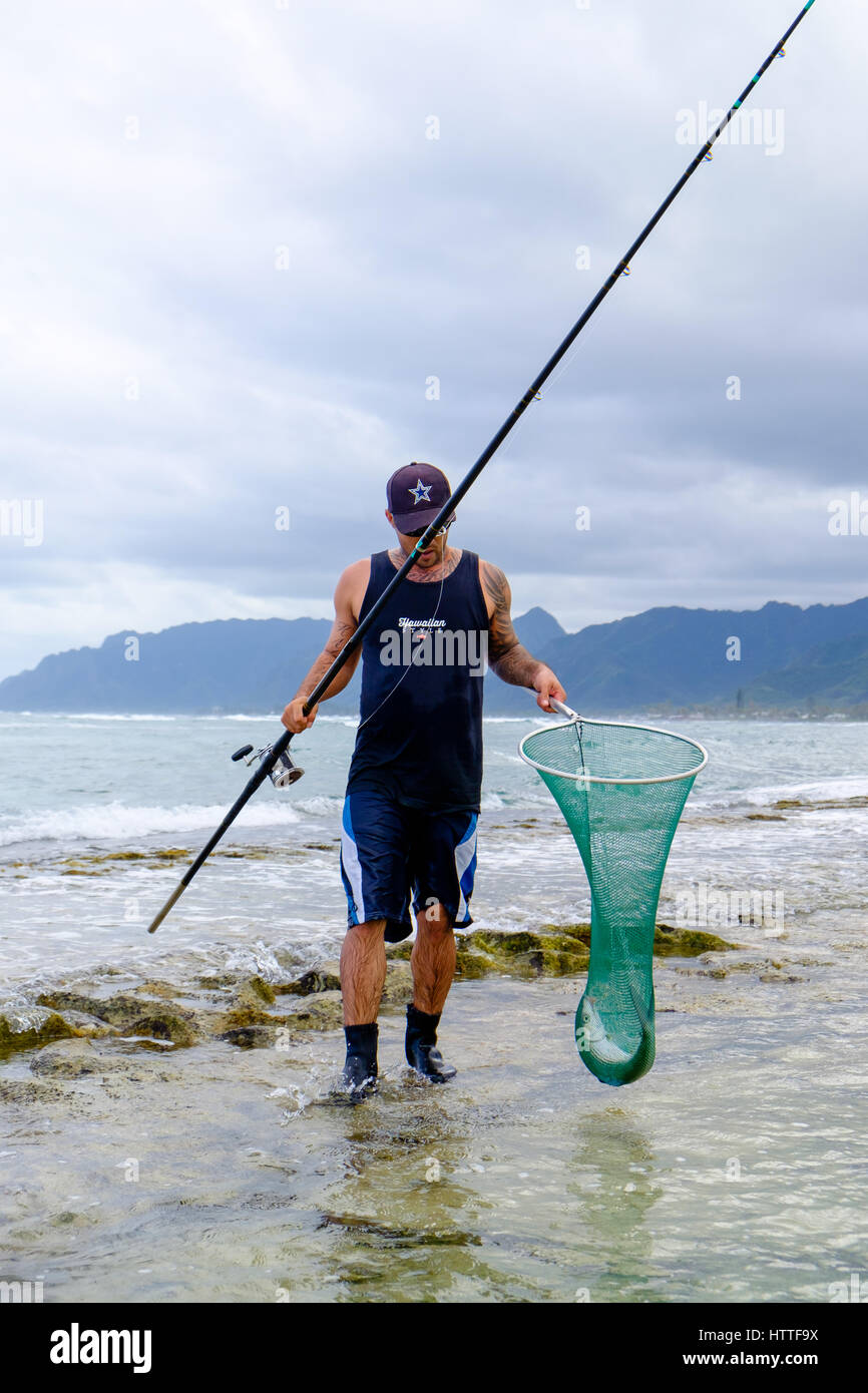 LAIE, HAWAII - FEBRUARY 24, 2017: Fisherman Jameson Humalon competes in a saltwater fishing tournament on Oahu targeting - Stock Image