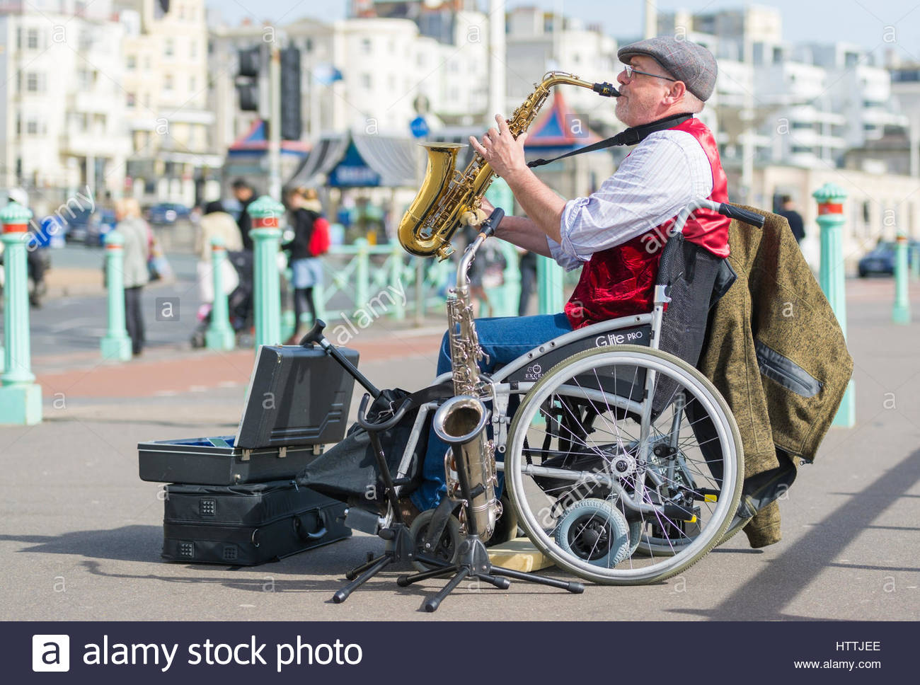 Disabled street entertainer and musician busking on the promenade in Brighton, East Sussex, England, UK. - Stock Image