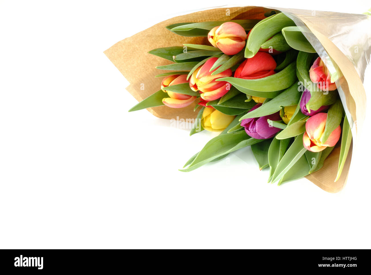 Flower bouquet brown paper stock photos flower bouquet brown paper bouquet of beautiful multicolored rainbow tulips wrapped in brown paper on white background with lots of mightylinksfo