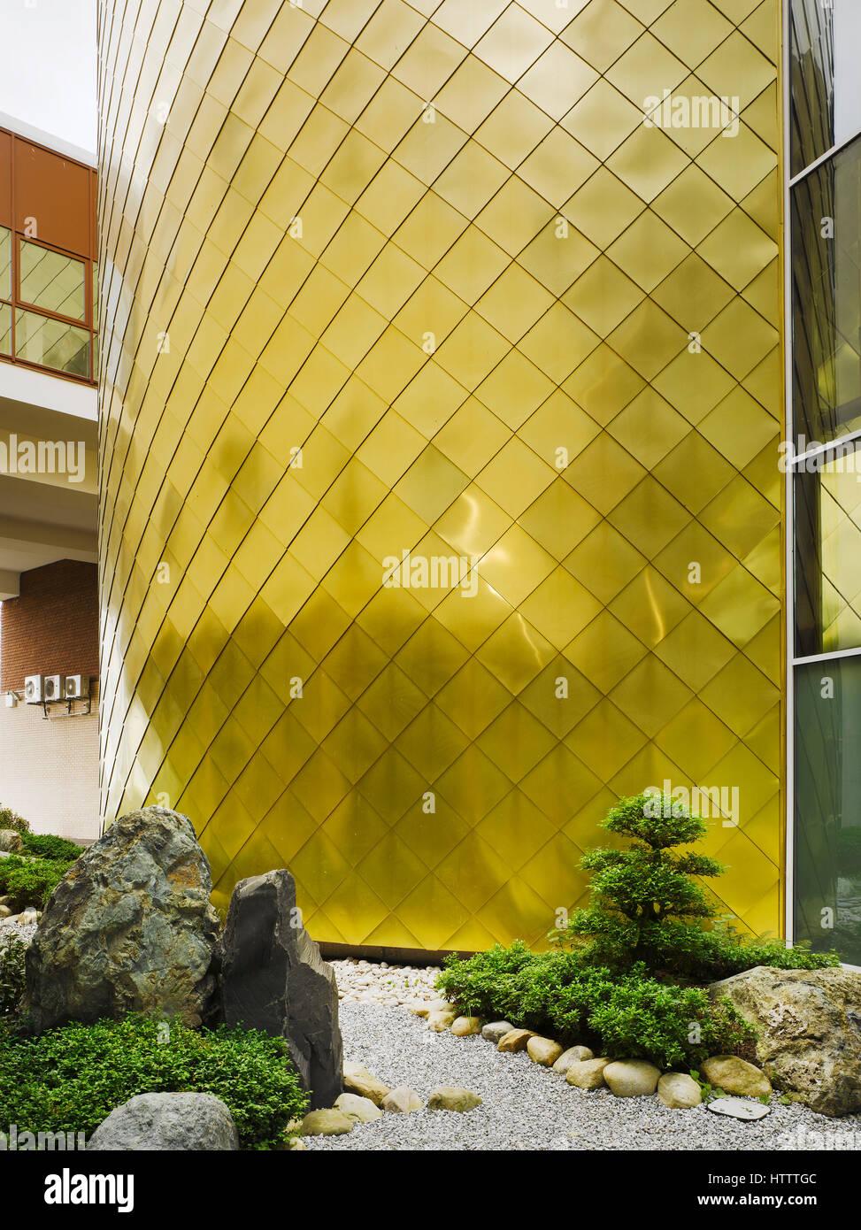 view of zen garden showing drum cladding irish world academy of