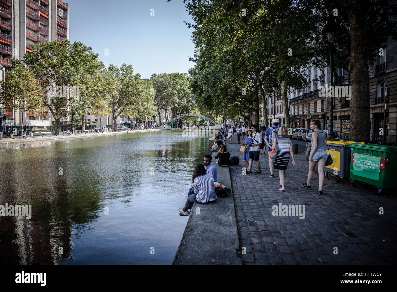 Beautiful canal Saint-Martin with its pedestrian bridges and locks in Paris, France - Stock Image
