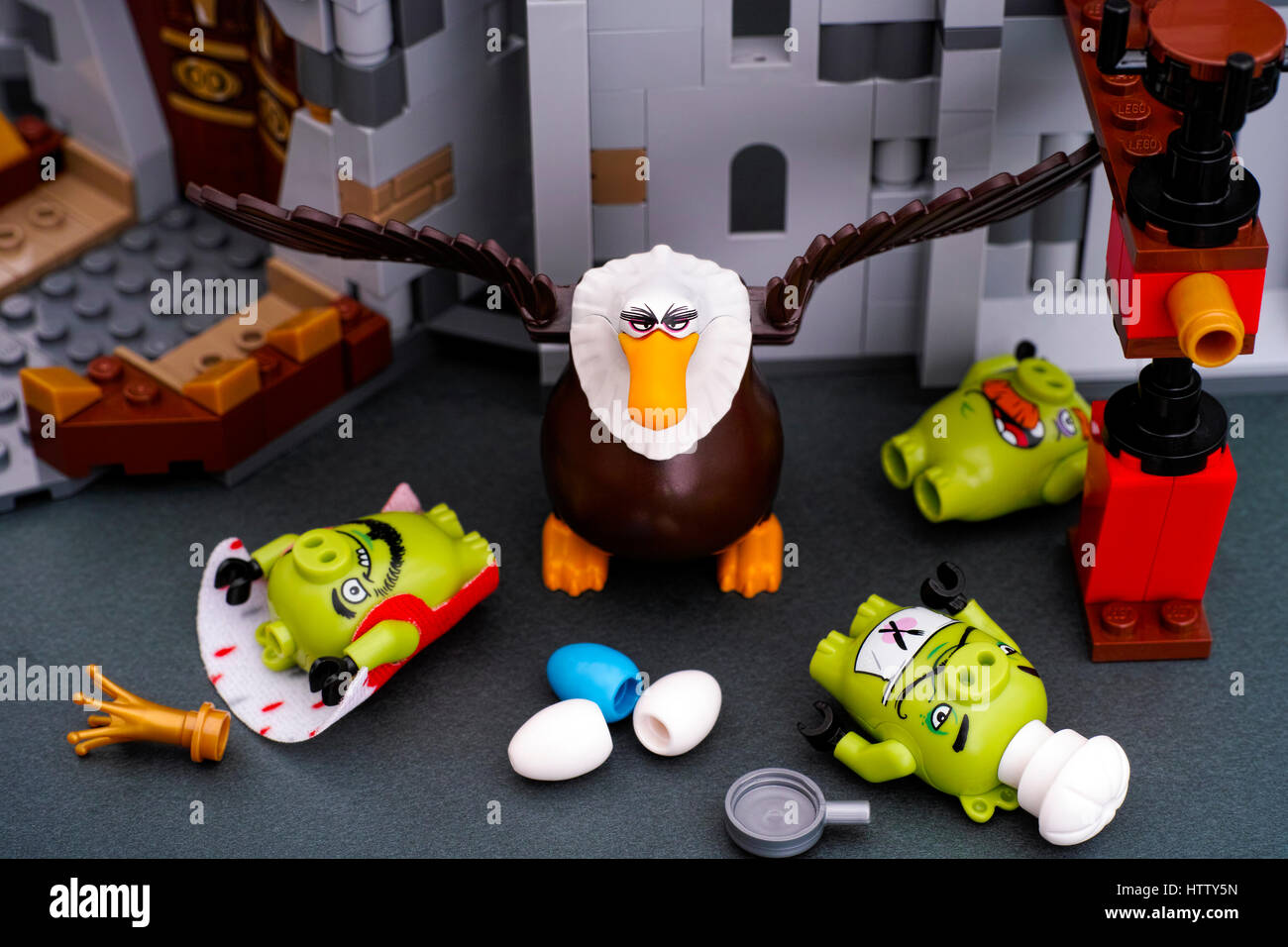 Tambov, Russian Federation - July 20, 2016 Lego Angry Birds. Three Bad Piggies defeated by Mighty Eagle near King - Stock Image