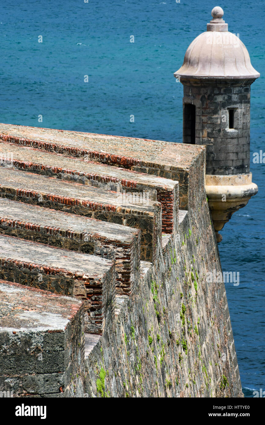 A section of the heavily fortified wall with a watch tower of the Castillo de San Cristobal Citadel in San JuanStock Photo