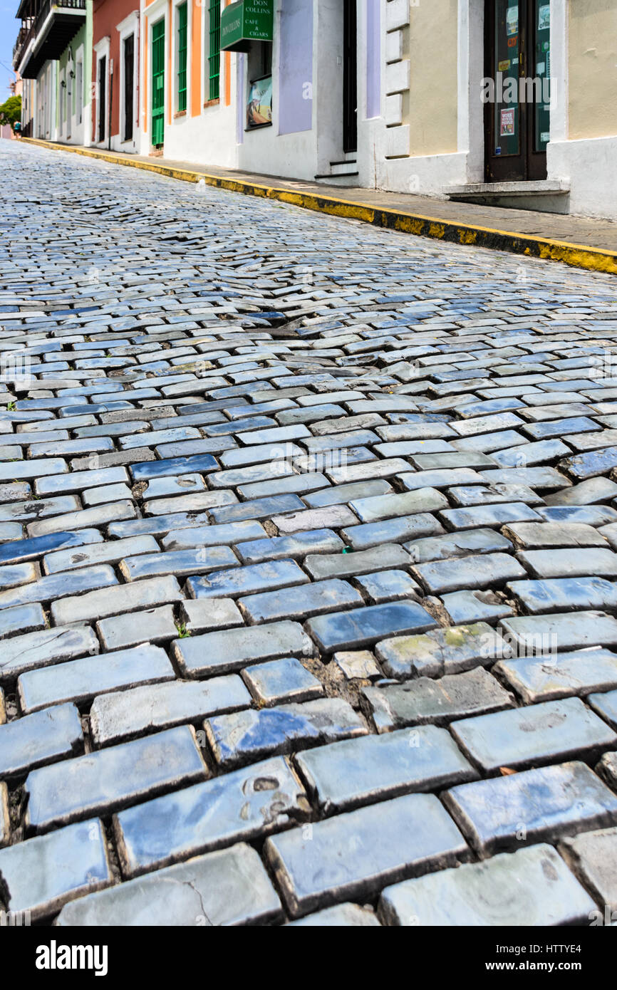 Subsiding cobbles on the steep road called Calle del Cristo in Old San Juan Stock Photo